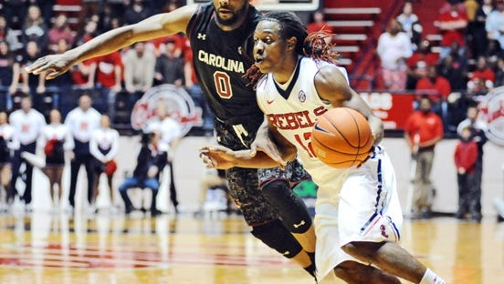 Mississippi guard Stefan Moody (42) drives against South Carolina guard Sindarius Thornwell (0) during an NCAA college basketball game in Oxford, Miss., Saturday, Jan. 10, 2015. (AP Photo/The Oxford Eagle, Bruce Newman) MAGAZINES OUT; NO SALES; MANDATORY CREDIT