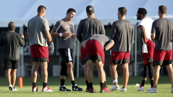 Tampa Bay Buccaneers quarterback Tom Brady, center, goes through practice with his teammates.