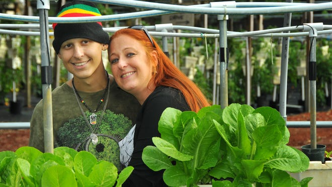Tyler Tennity has stage IV Ewing's sarcoma. The 15-year-old loves to garden and be outside but cannot really be exposed to dirt anymore due to having no immune system. Sara Redmond with Medals 4 Mettle heard of his plight and was able to coordinate with Rockledge Gardens to donate a hydroponic garden to the teen. Tyler with his mom, Liisa Stephan.