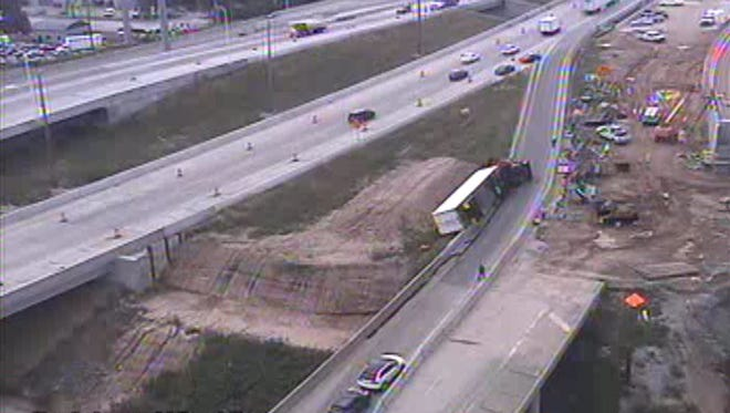 Overturned semi in the Zoo Interchange