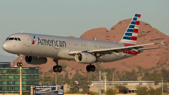 An American Airlines Airbus A321 jet lands at Phoenix Sky Harbor International Airport on Feb. 2, 2015.
