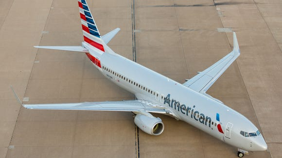 An American Airlines Boeing 737 taxies to a gate at