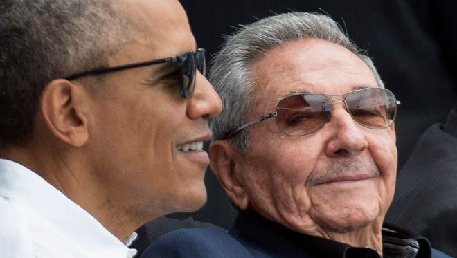 President Obama, left, and Cuban President Raul Castro attend a Major League Baseball exhibition game between the Tampa Bay Rays and the Cuban national team at Latin American Stadium in Havana on March 22, 2016.