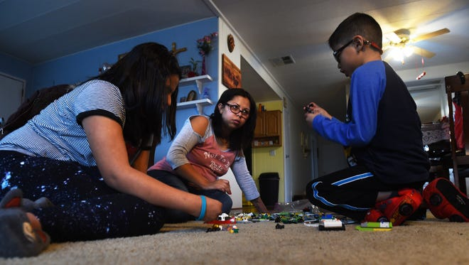 DACA student Maria Roberto, middle, plays with Legos with her children Ashlee Romano, left, and Gerardo Mederos in her home in Reno on Feb. 7, 2017.