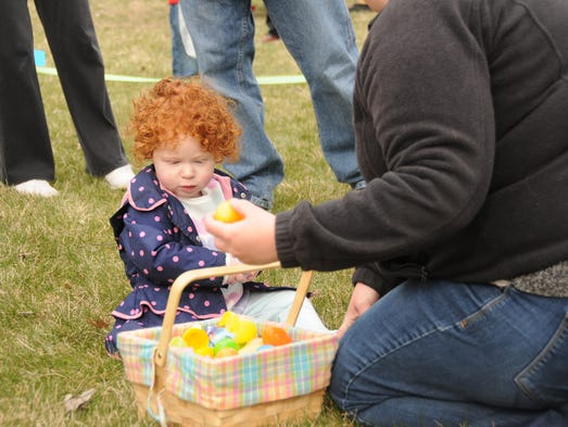 Fran Newman sorts through her basket full of eggs on