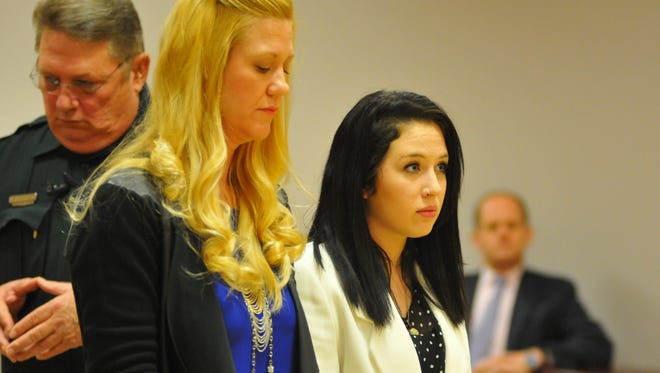 "Jessica Umberger in court with her attorney Tamara Meister. Both Jessica ""Jessie"" Umberger and Rebecca Gotay went before Circuit Judge James Earp at the Moore Justice Center to plead guilty to aggravated battery, a  2nd degree felony. The victim of the February crowbar attack, Daniel Vukovich and his family were at the hearing."