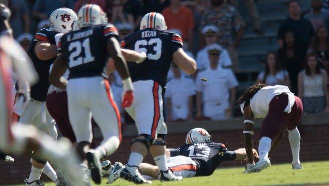 Auburn Tigers quarterback Sean White (13) fumbles the ball during the Auburn vs. ULM NCAA football game on Saturday, Oct. 1, 2016, in Auburn, Ala.