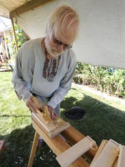 Owen Christianson of Stratford demonstrates his woodworking