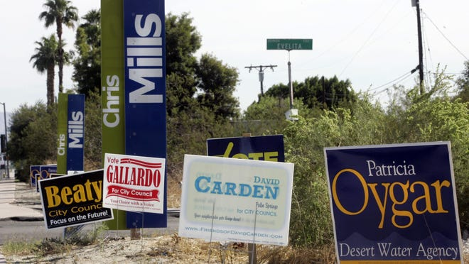 Political signs line the corner of Evelita and Ramon in Palm Springs, on Oct. 30, 2009.