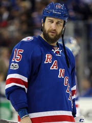Rangers left wing Tanner Glass (15) reacts after losing