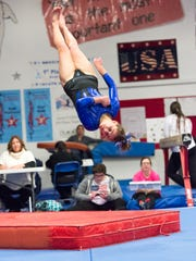 Ava Farquhar competes in floor exercises where she