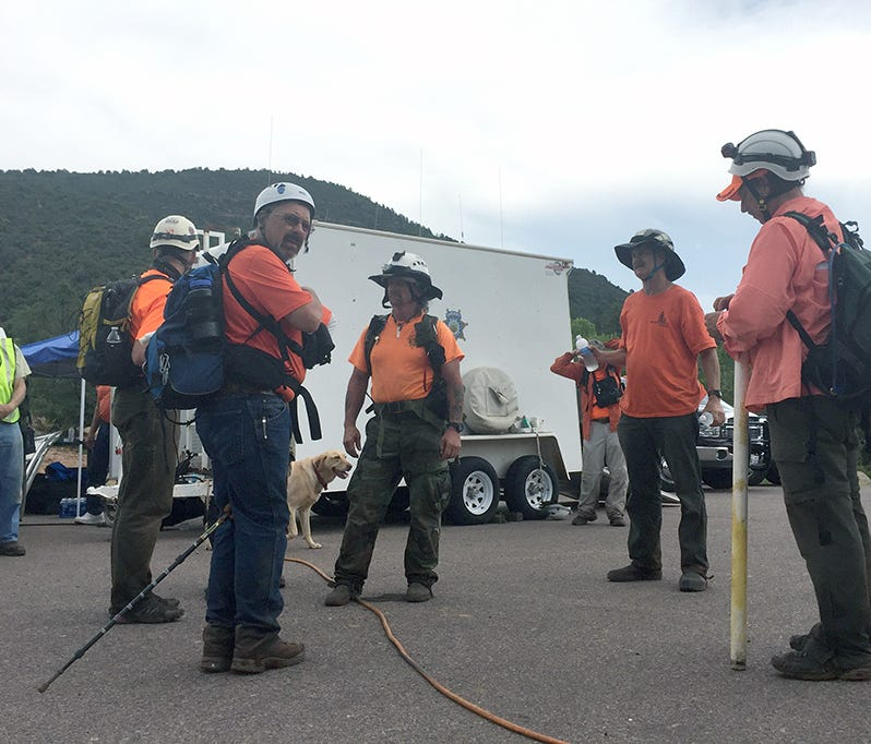 A group of first responders near where a flash flood killed at least nine people in Tonto National Forest.