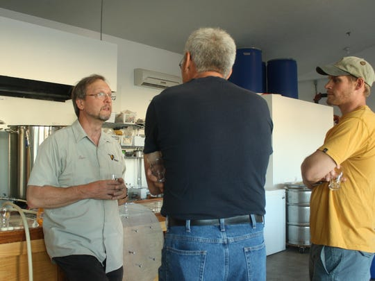 Tom Bullinger of The VB Brewery, left, speaks with participants at Community Brew Night on Tuesday.