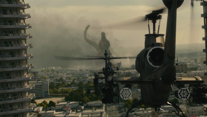 "Godzilla under fire in a scene from ""Shin Godzilla."""