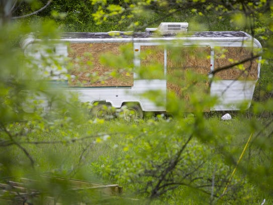 A camper sits boarded up May 18 at 1084 Left Fork Road