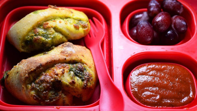 Spinach pesto pizza rollups can be served cold with a little pizza dipping sauce.