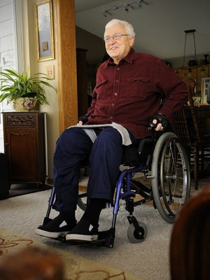 Roger Illies of Cold Spring talks in 2011 about the accident that paralyzed him from the waist down in October after a fall from a ladder at his home. Illies led the Rocori baseball team to a championship in 1992 and his son Jeff, who is the coach, took the team to the championship in 2010.