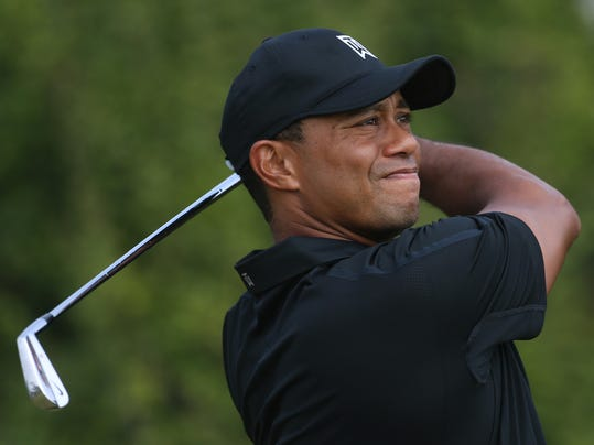 Tiger Woods of the US plays a shot off the 8th tee during the second day of the British Open Golf championship at the Royal Liverpool golf club, Hoylake, England, Friday July 18, 2014. (AP Photo/Peter Morrison)