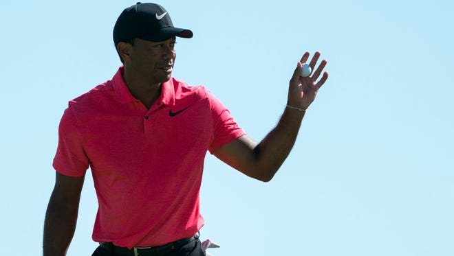 Tiger Woods acknowledges the crowd after making a putt on the ninth hole during the final round of the Hero World Challenge golf tournament in December.