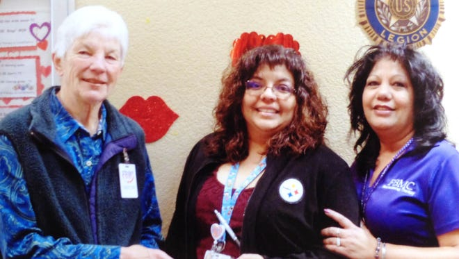New Mexico Chapter of American Gold Star Mothers member Mary Cowan, left, recently presented a $250 donation for the veteran's wing of the Fort Bayard Medical Center to Kathy Fletcher, center, social worker, and Mary Muniz, recreation worker. The mission of the AGSM is to give aid to veterans though voluntary service, monetary or material contributions.
