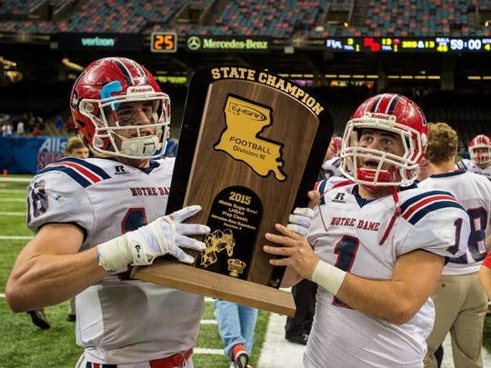 FILE --Notre Dame Pioneers hold the Division III state championship trophy after beating Riverside Academy 13-3 in the Mercedes-Benz Superdome.