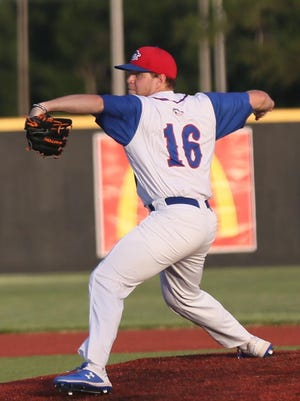 Wyatt Divis brings a pitch to the plate on Thursday against the Denver Cougars.