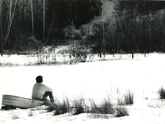 A visitor looks out on the SUNY Binghamton nature preserve in February 1973.