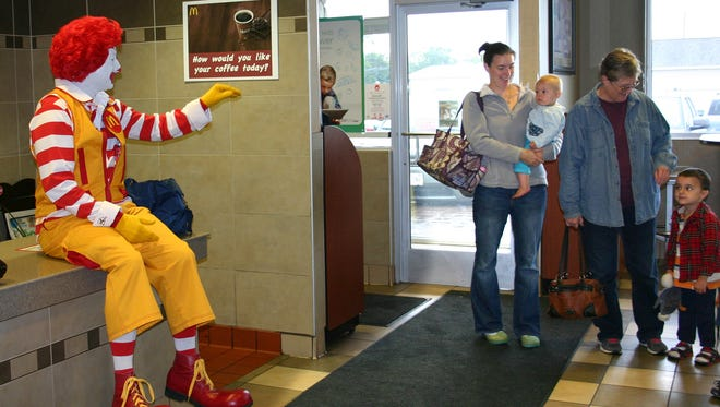 Ronald McDonald greets unsuspecting patrons during the 2014 United Way Day at McDonald's. A portion of the proceeds was donated to United Way of Inner Wisconsin.