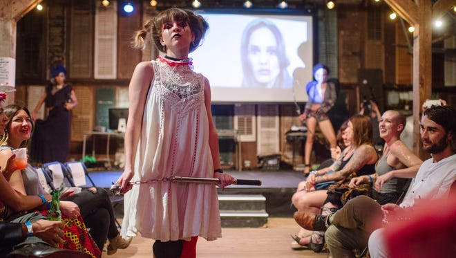 Londri will hold an art installation during June's ArtWalk, one week ahead of its spring fashion show. Pictured is one of the magazine's fall fashion shows, featuring zodiac-inspired looks. Sara Crochet shows a Capricorn-inspired look by Shop Three Little Birds.