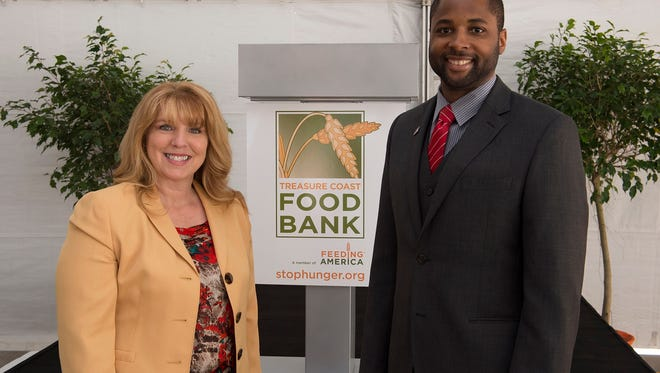 Treasure Coast Food Bank President & CEO Judith Cruz and Izra Brown, finance director of the US Department of Agriculture, at the March 2017 Grand Opening of Treasure Coast Food Bank's fresh food production plant.