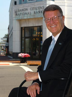 In this 2010 photo, Stephen Wilson, outgoing chairman and CEO of LCNB National Bank, poses by his bank on Broadway in Lebanon.