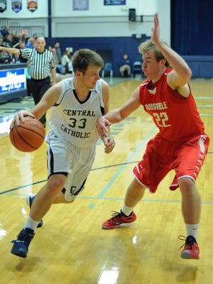 Sophomore guard Ben Tharp drives to the basket Saturday night at Central Catholic.