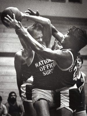 Mangilao's Ernie Hernandez (with ball) is hounded by Inarajan's Paul Cruz in the GBC championship game at the UOG fieldhouse. Photo archive date Sept. 10, 1988.