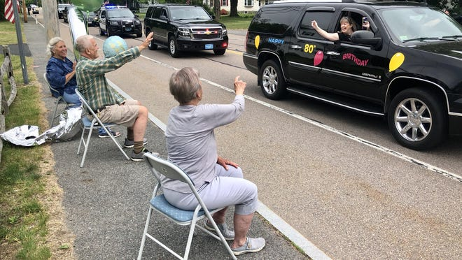 Triplets Norma Pineo, left, Neil Pineo and Nancy Bourdeau, were treated to a birthday parade in Raynham on Friday marking their 80th birthday.