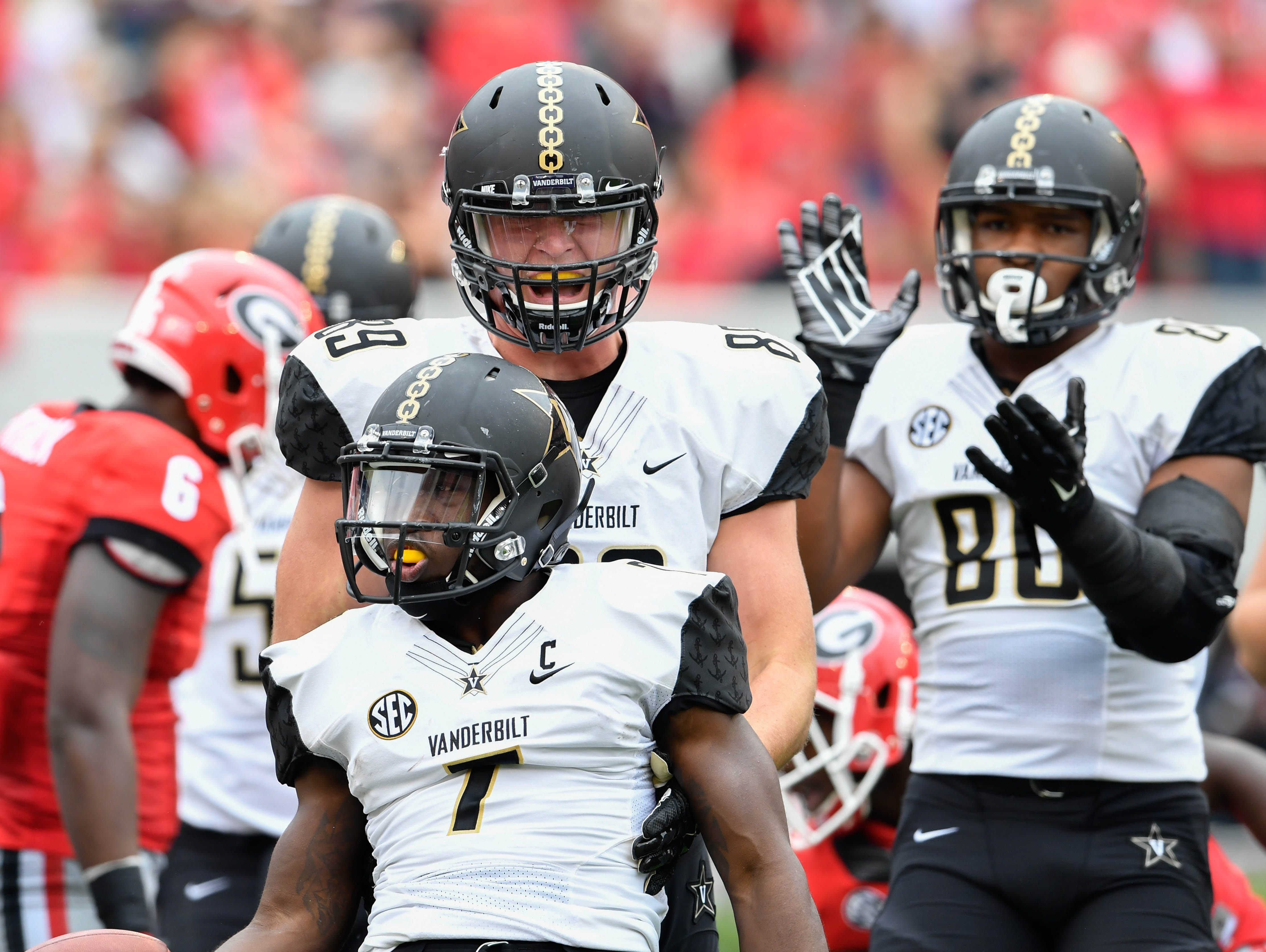 Vanderbilt running back Ralph Webb (7) celebrates with teammates after scoring against Georgia during the first quarter of last season's game Oct 15, 2016.