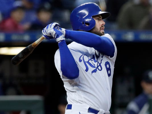 Kansas City Royals' Mike Moustakas hits an RBI-double off Seattle Mariners starting pitcher Marco Gonzales during the first inning of a baseball game at Kauffman Stadium in Kansas City, Mo., Monday, April 9, 2018. (AP Photo/Orlin Wagner)