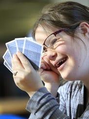 Syble Hopp student Morgan Bodart plays a game of cards