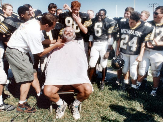 Until 1993, Butch Simpson had worn a beard for 19 years. Here, Jeff Longfellow shaves it off to celebrate a Newark win over Caesar Rodney.