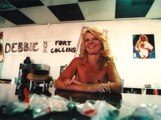 Cathy Pryor, a waitress at Debbie Duz Donuts, is seen on opening day, July 29, 1989.