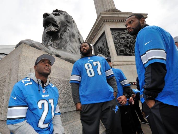 From left, Lions players Reggie Bush, Brandon Pettigrew