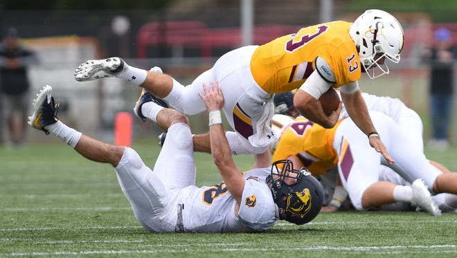 Salisbury quarterback Ryan Jones carries for a gain against The College of New Jersey's Thomas Koenig.