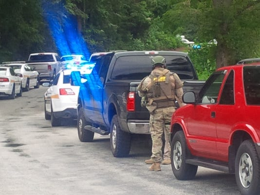 man barricaded Bowman Road
