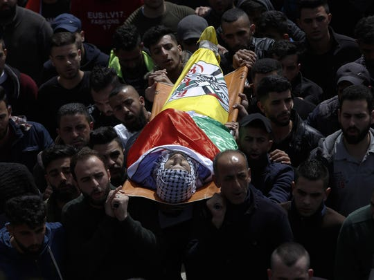 Palestinians cary the body of Mohammed Shahin during his funeral in the West Bank town of Salfit, Wednesday, March 13, 2019. Shahin was killed during stone-throwing clashes with Israeli troops in the northern West Bank village of Salfit Tuesday.