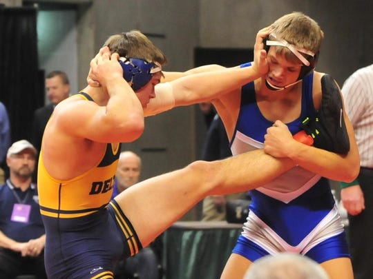 Delta's Jacob Gray wrestles in the quarterfinal round of state on Saturday. In the championship round, Gray scored a takedown in the closing seconds to win a state title.