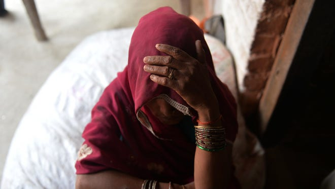 The mother of one of the gang-rape victims looks on at Katra Shahadatgunj in Badaun, India's Uttar Pradesh state, on May 31, 2014.