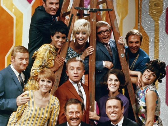 "A ""Laugh-In"" cast photo, with Ruth Buzzi in purple shirt."
