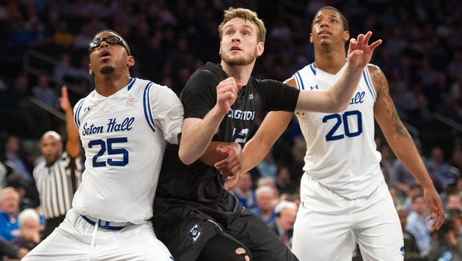 Seton Hall Pirates forwards Rashed Anthony (25) and Desi Rodriguez (20) defend against Creighton Bluejays guard Malik Albert (12) in the first half during the Big East conference tournament at Madison Square Garden.