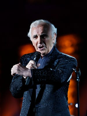 In this July 9, 2009 file photo, French singer Charles Aznavour performs during a concert at the annual Beiteddine cultural festival in the central Chouf mountains east of Beirut, Lebanon.