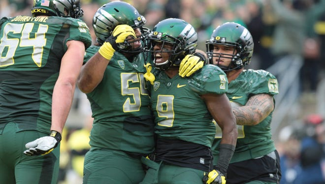 Oregon players celebrate after a big play in their win against UCLA.