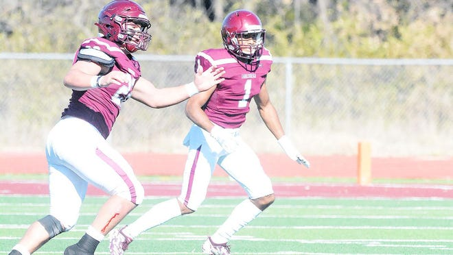 Bethel players Josh Seabolt (22) and  Phillip Williams (1) watch a pass go by for an incompletion during play last season against Saint Mary. Bethel is scheduled to open the season Sept. 12 at home against Avila.